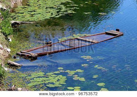 Sunken wooden river boat