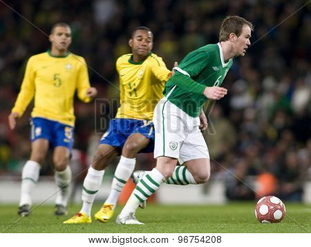 LONDON, ENGLAND. March 02 2010: Ireland's Glenn Whelan during the international football friendly between Brazil and the Republic of Ireland played at the Emirates Stadium.