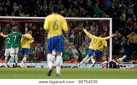 LONDON, ENGLAND. March 02 2010: Brazil team celebrate after Ireland's Keith Andrews deflects the ball into his own goal during the international football between Brazil and the Republic of Ireland