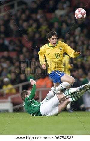 LONDON, ENGLAND. March 02 2010: Ireland's Keith Andrews slides in and tackles Brazil's Kaka during the international football friendly between Brazil and the Republic of Ireland