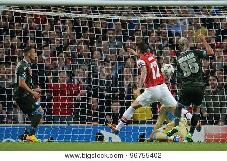 LONDON, ENGLAND - Oct 01 2013: Napoli's midfielder Valon Behrami fails to stop Arsenal's forward Olivier Giroud from scoring a goal during the UEFA Champions League match between Arsenal and Napoli.