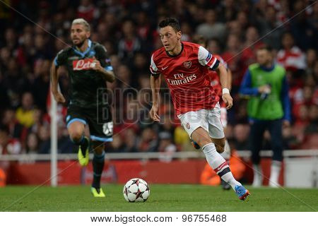 LONDON, ENGLAND - Oct 01:Arsenal's midfielder Mesut Ozil from Germany runs with the ball during the UEFA Champions League match between Arsenal and Napoli.