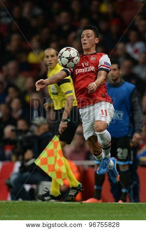 LONDON, ENGLAND - Oct 01 2013: Arsenal's midfielder Mesut Ozil from Germany controls the ball during the UEFA Champions League match between Arsenal and Napoli.
