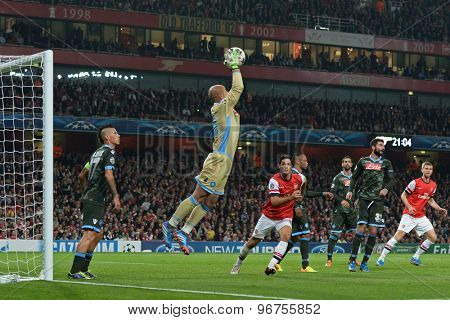 LONDON, ENGLAND - Oct 01 2013: Napoli's goalkeeper Pepe Reina from Spain catches the ball during the UEFA Champions League match between Arsenal and Napoli.