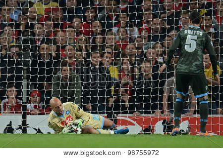 LONDON, ENGLAND - Oct 01 2013: Napoli's goalkeeper Pepe Reina from Spain makes a save during the UEFA Champions League match between Arsenal and Napoli.