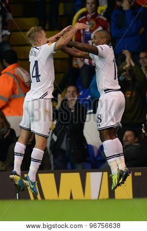LONDON, ENGLAND - September 19 2013: Tottenham's Lewis Holtby and Tottenham's Jermain Defoe  celebrate a goal during the UEFA Europa League match between Tottenham Hotspur and Tromso