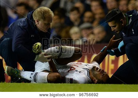 LONDON, ENGLAND - September 19 2013: Tottenham's Mousa Dembele sustains an injury during the UEFA Europa League match between Tottenham Hotspur and Tromso played at The White Hart Lane Stadium.