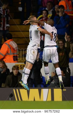 LONDON, ENGLAND - September 19 2013: Tottenham's Lewis Holtby and Tottenham's Jermain Defoe celebrate Defoe scoring a goal during the UEFA Europa League match between Tottenham Hotspur and Tromso