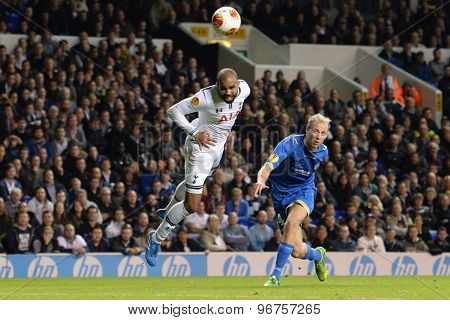 LONDON, ENGLAND - September 19 2013: Tottenham's Sandro heads the ball towards the Tromso goal during the UEFA Europa League match between Tottenham Hotspur and Tromso played at The White Hart Lane