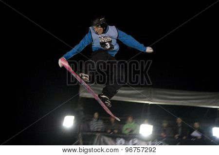 LONDON, ENGLAND. October 30 2009 A competitor takes to the air during the skiers vs snowboarders exhibition competition at the London Freeze snowboard and freestyle skiing event.
