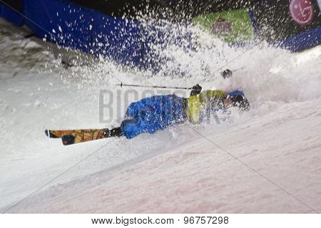 LONDON, ENGLAND. October 30 2009 A competitor crash lands during the skiers vs snowboarders exhibition competition at the London Freeze snowboard and freestyle skiing event.