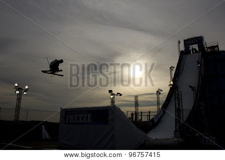 LONDON, ENGLAND. October 30 2009 A silhouette of a competitor jumping during the Battle of Britain Big Air freestyle skiing competition at the London Freeze snowboard and freestyle skiing event.