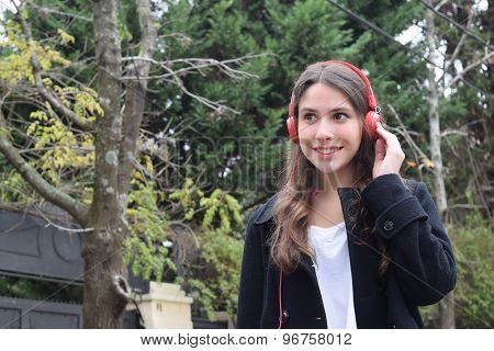 Latin Young Woman With Headphones.
