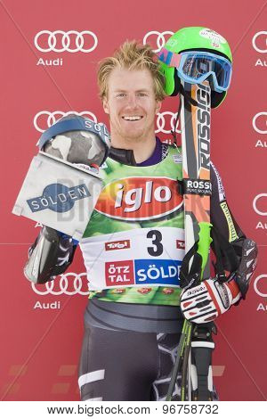 SOELDEN, AUSTRIA Oct 25 2009 Ted Ligety (USA) with his trophy for finishing 2nd in the mens giant slalom race at the Rettenbach Glacier.