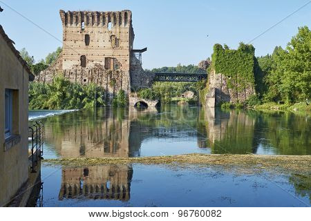 BORGHETTO, ITALY - JULY 11: Ruin of tower at Visconteo bridge coasted by river Mincio. July 11, 2015 in Borghetto.