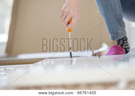Person Assembling Flat Pack Furniture