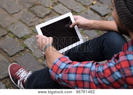 Young Man Using A Tablet.