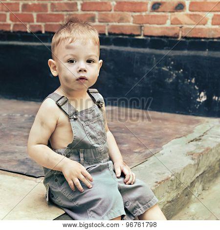 Little Boy Little Boy Sitting On The Steps