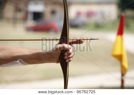 Arrow And Bow In Hands Of An Unidentified Archer