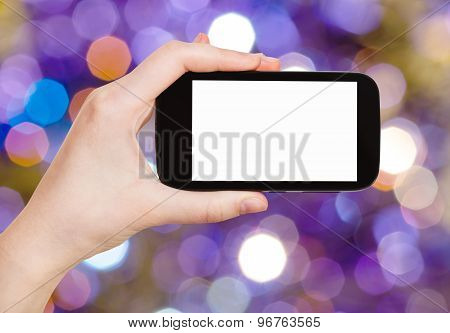 Hand With Smartphone On Blurred Violet Background