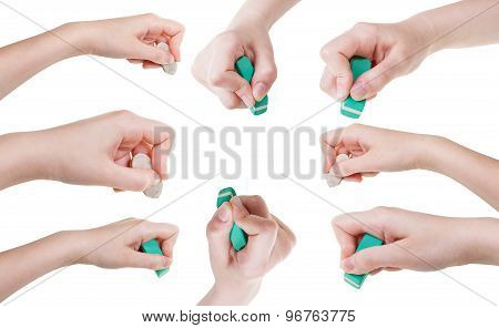 Set Of Hands With Rubber Eraser Close Up Isolated