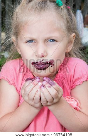 Girl eats berries