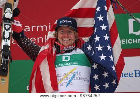 GARMISCH PARTENKIRCHEN, GERMANY. Feb 18 2011: Race winner Ted Ligety (USA) in the finish area of the mens giant slalom race on the Kandahar race piste at the 2011 Alpine skiing World Championships