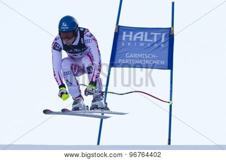 GARMISCH PARTENKIRCHEN, GERMANY. Feb 14 2011: Benjamin Raich (AUT) takes to the air competing in the men's downhill at the 2011 Alpine skiing World Championships