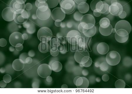 dark green circle shape boke background