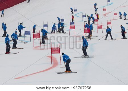 GARMISCH PARTENKIRCHEN, GERMANY. Feb 16 2011: Course workers repair the piste between runs at the team event a parallel slalom race  at the 2011 Alpine skiing World Championships