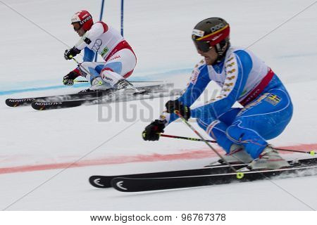 GARMISCH PARTENKIRCHEN, GERMANY. Feb 16 2011: Beat Fuez (SUI) (top) and Hans Olsson (SWE) (bottom) competing in the team event a parallel slalom race  at the 2011 Alpine skiing World Championships