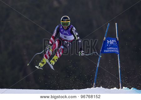 GARMISCH PARTENKIRCHEN, GERMANY. Feb 12 2011: Steven Nyman (USA) takes to the air competing in the men's downhill at the 2011 Alpine skiing World Championships