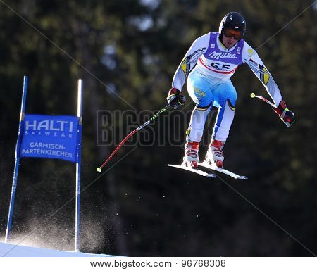GARMISCH PARTENKIRCHEN, GERMANY. Feb 10 2011: Igor Zakurdaev (KAZ) takes to the air competing in the men's downhill training at the 2011 Alpine Skiing World Championships