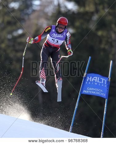 GARMISCH PARTENKIRCHEN, GERMANY. Feb 10 2011: Tin Siroki (CRO) takes to the air competing in the men's downhill training at the 2011 Alpine Skiing World Championships
