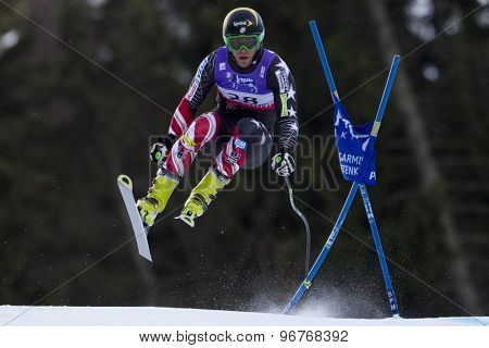 GARMISCH PARTENKIRCHEN, GERMANY. Feb 10 2011: Steven Nyman (USA) takes to the air competing in the men's downhill training at the 2011 Alpine Skiing World Championships