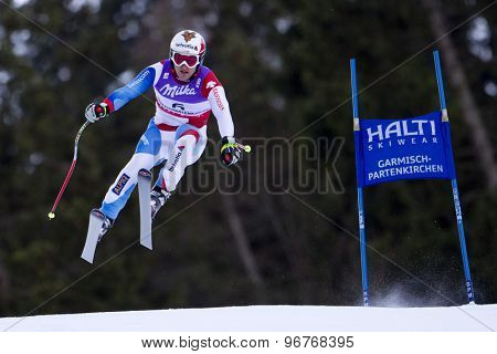 GARMISCH PARTENKIRCHEN, GERMANY. Feb 10 2011: Ambrosi Hoffmann (SUI) takes to the air competing in the men's downhill training at the 2011 Alpine Skiing World Championships