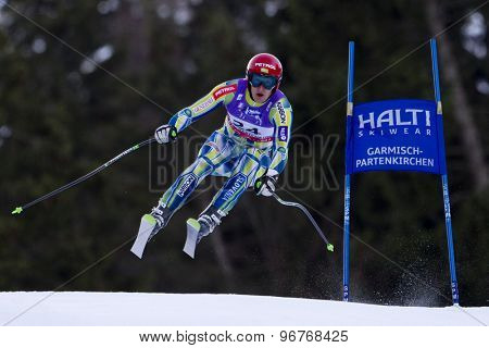 GARMISCH PARTENKIRCHEN, GERMANY. Feb 10 2011: Andrej Sporn (SLO) takes to the air competing in the men's downhill training at the 2011 Alpine Skiing World Championships