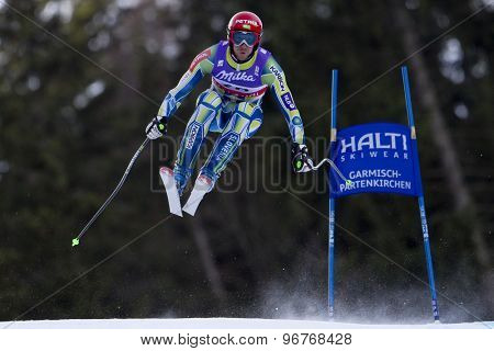 GARMISCH PARTENKIRCHEN, GERMANY. Feb 10 2011: Andrej Jerman (SLO) takes to the air competing in the men's downhill training at the 2011 Alpine Skiing World Championships