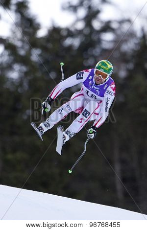 GARMISCH PARTENKIRCHEN, GERMANY. Feb 10 2011: Klaus Kroell (AUT) takes to the air competing in the men's downhill training at the 2011 Alpine Skiing World Championships