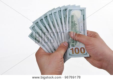 Hands holding dollar cash