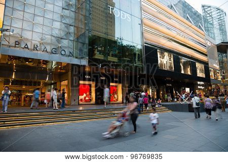 SINGAPORE - CIRCA FEBRUARY, 2015: People walk the Orchard Road - is a 2.2 kilometre long boulevard that is the retail and entertainment hub of Singapore. It is a huge tourist attraction, evening.