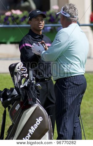 ST ANDREWS, SCOTLAND. July 17 2010: Tiger WOODS from the USA and Darren CLARKE from Northern Ireland during the third round of The Open Championship played on The Royal and Ancient Old Course