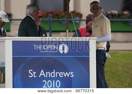 ST ANDREWS, SCOTLAND. July 17 2010: Ivor Robson the official announcer and Marcel SIEM from Germany during the third round of The Open Championship   played on The Royal and Ancient Old Course