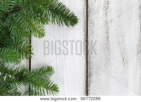 Nobel Fir Branch On Rustic White Wooden Boards