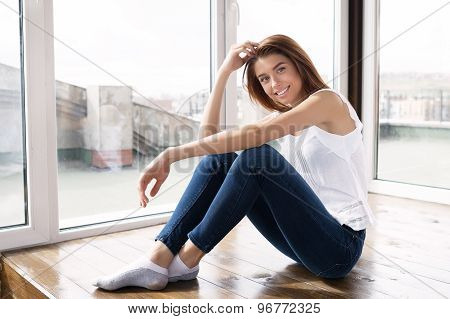 Smiling Beautiful Girl In Blue Jeans