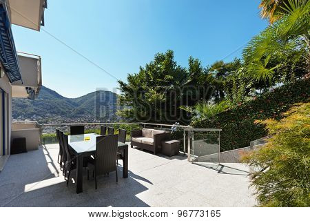 terrace of a building, dining table and divan, outdoors