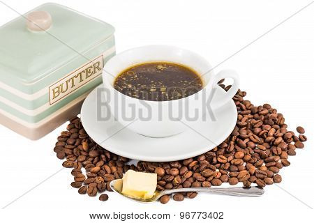 Black coffee with added butter served in cup and saucer