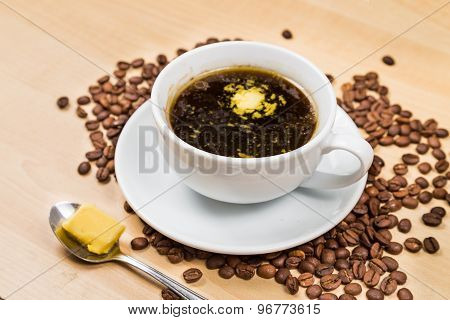 Coffee with added butter and with coffee beans as props