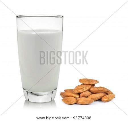 Almonds And Milk On A White Wooden Background