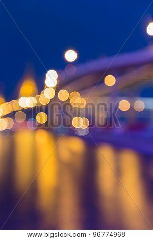 Blurred bokeh lights of city bridge at night